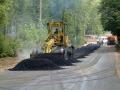 Работы по поднятию дорожного полотна проспекта, август 2001 года