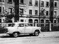 Улица Комсомольская, автомобиль Москвич 402 и Дом №12 (Промтоварный магазин), 1960-е годы