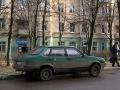 Улица Комсомольская, автомобиль ВАЗ-21099 и дом №12 (магазин Радуга), 2006 год