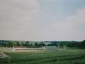 На заднем плане - строительство стадиона. Желтый ангар слева - новая лодочная станция, 1990-е годы