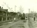 Грузовые автомобили на улице Новая жизнь, на заднем плане дом 12, 1950-е годы