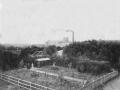"Вид от улицы Чкалова на Вознесенскую мануфактуру, на среднем плане виден ""висячий"" мост, начало XX века"